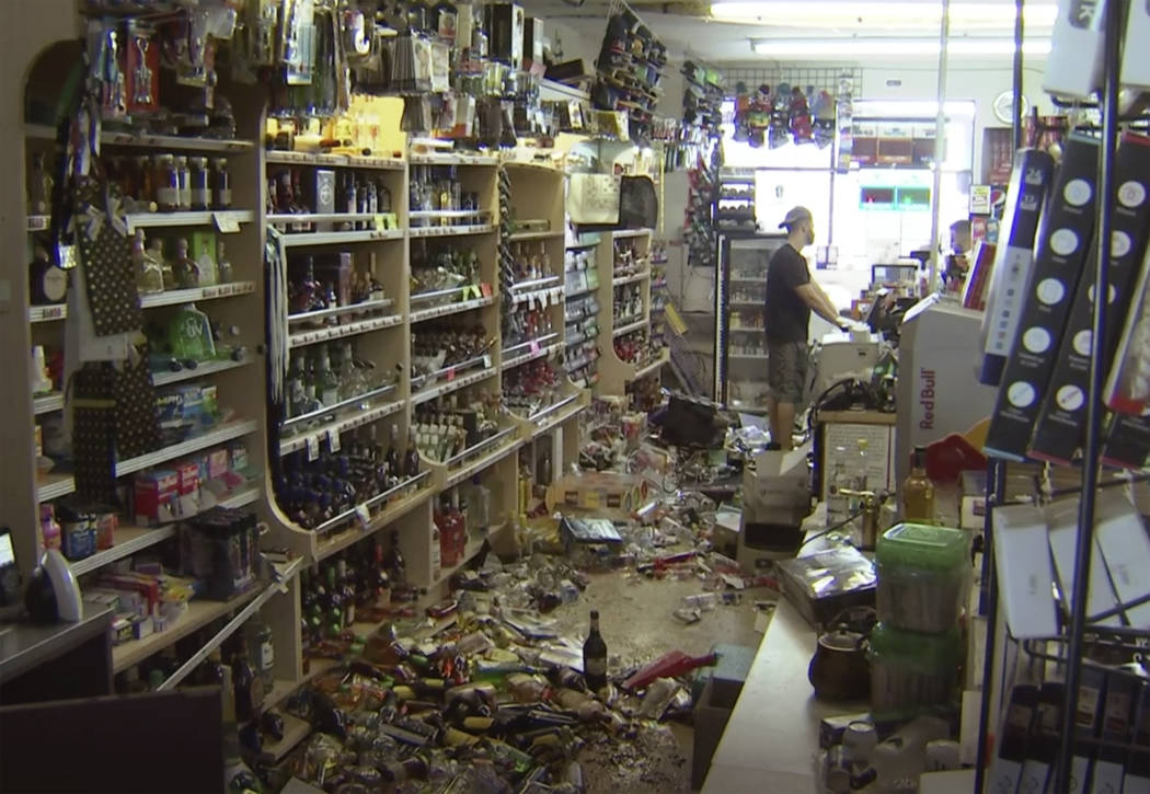 This still image taken from video shows bottles and debris on the floor of a liquor store as a ...
