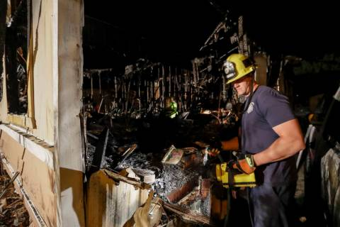 A fireman looks over a home Saturday, July 6, 2019 that burned after a earthquake in Ridgecrest ...