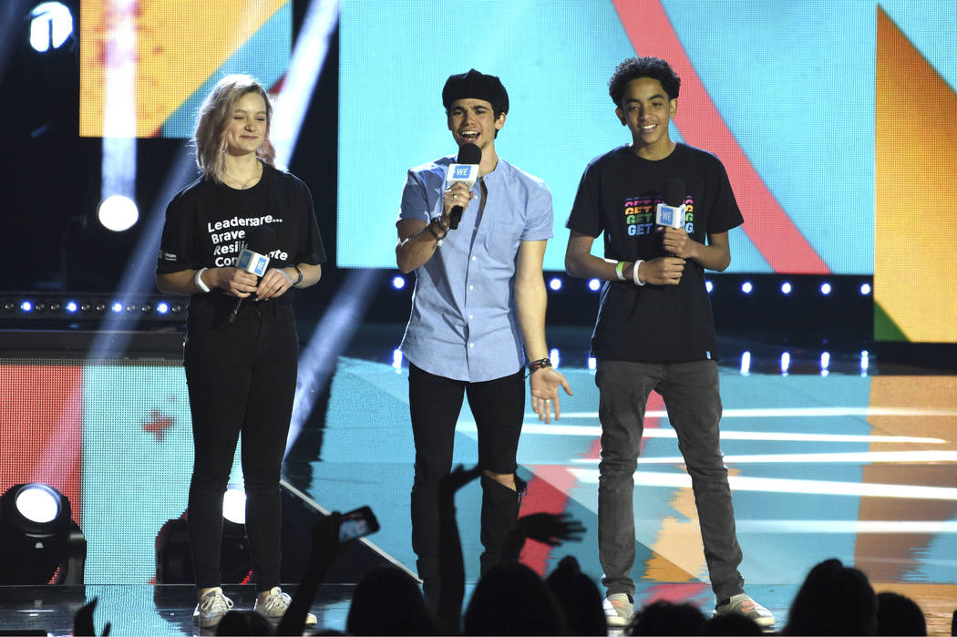 Cameron Boyce speaks at WE Day California, with Macy Lillard, left, and Jazzy Satten at The For ...