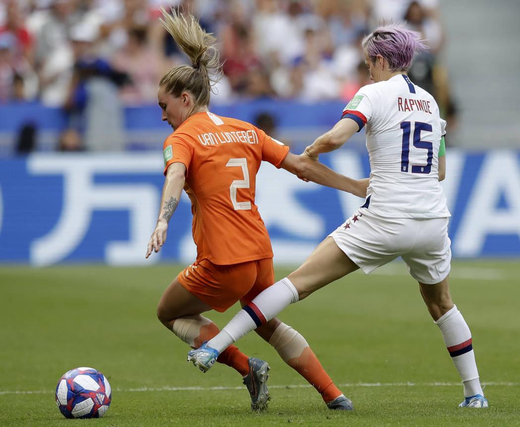 United States' Megan Rapinoe, right, challenges Netherlands' Desiree Van Lunteren, left, during ...