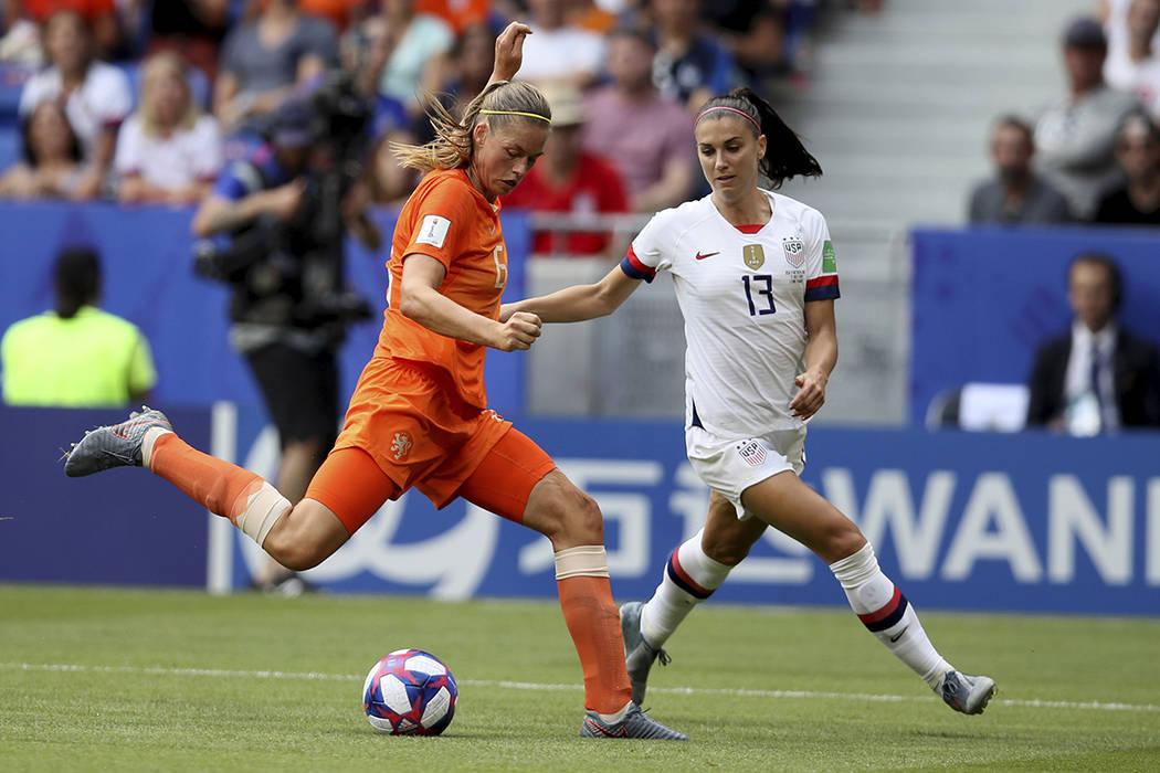 Netherlands' Anouk Dekker, left, is challenged by United States' Emily Sonnett during the Women ...