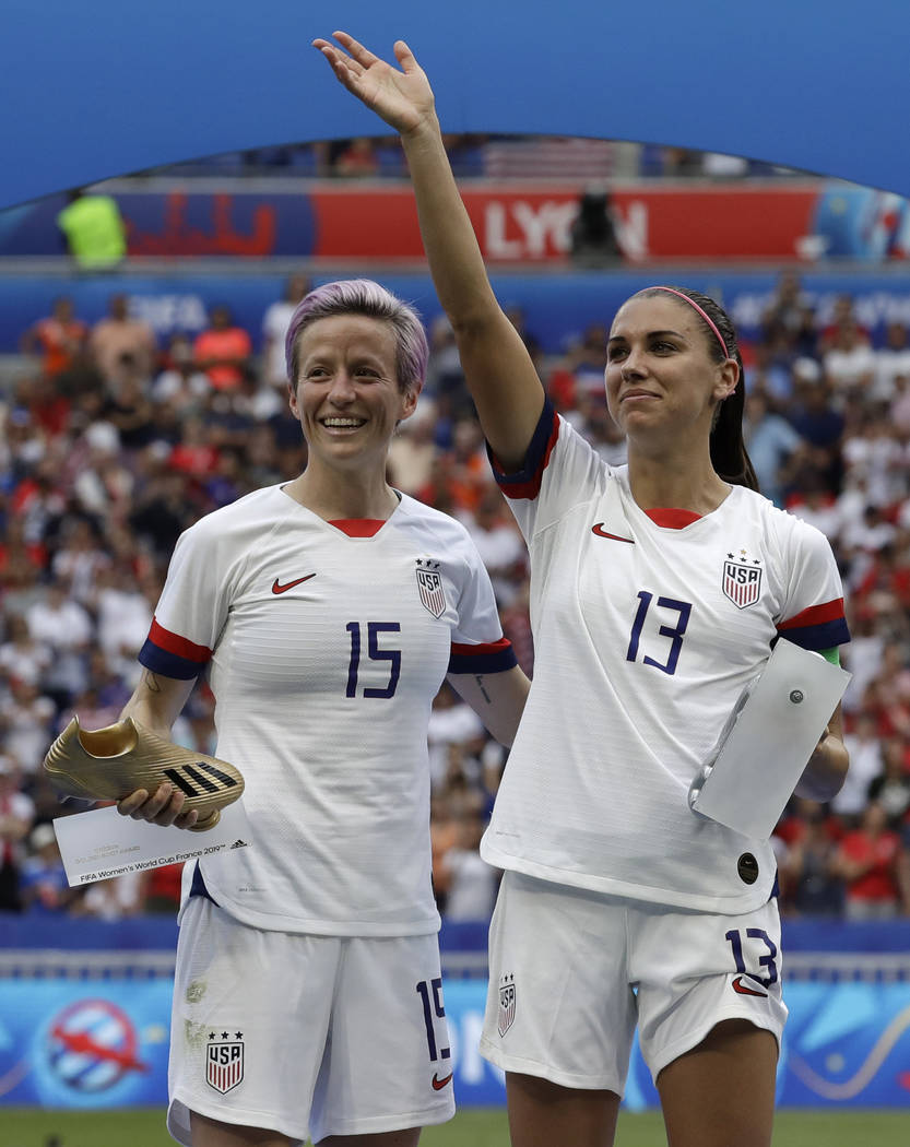 United States' Megan Rapinoe, left, and her teammate Alex Morgan, right, after winning the Wome ...