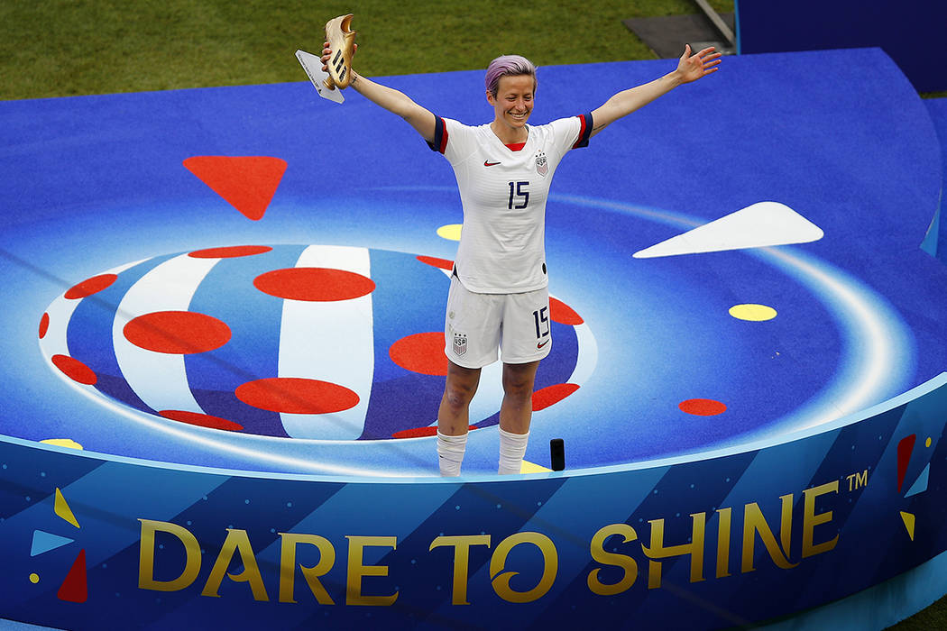 United States' Megan Rapinoe celebrates with the golden soccer shoe after her team won the Wome ...