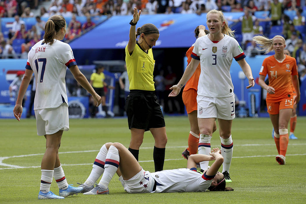 United States' Alex Morgan lays on the ground after she was faulted during the Women's World Cu ...