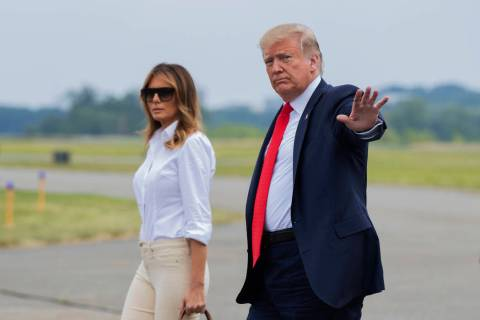 President Donald Trump and first lady Melania Trump, walk on the tarmac upon arrival at Morrist ...