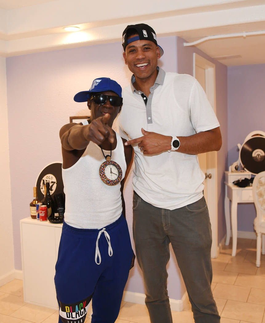 LAS VEGAS, NV - JULY 06: Flavor Flav and professional basketball player Allan Houston attend t ...