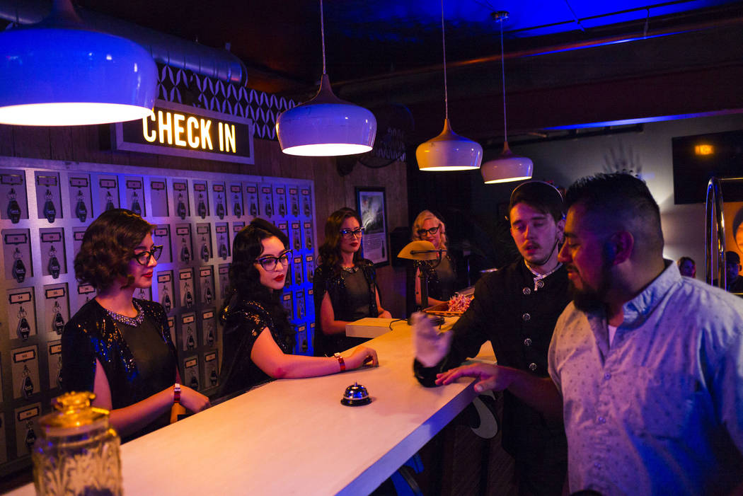 Attendees stop by the check in desk during the Jack Daniel's House No. 7, a pop-up experience a ...