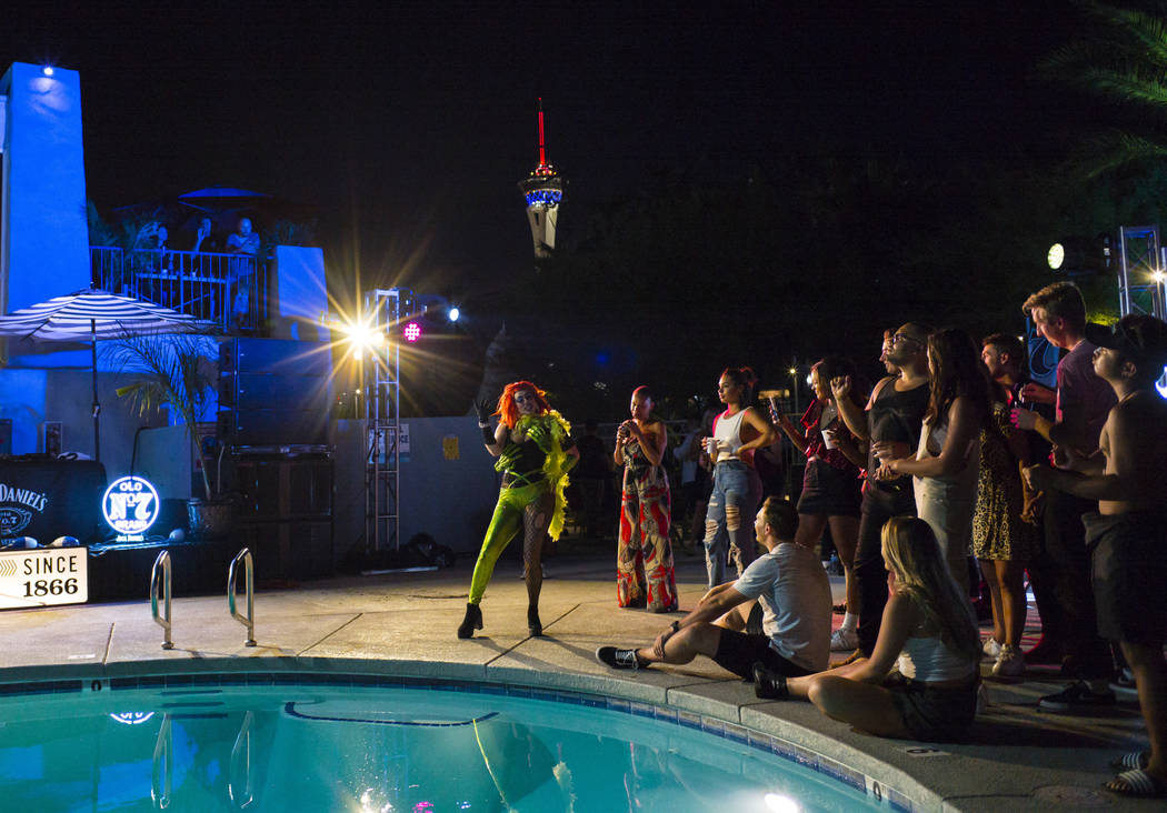 Attendees watch a drag show competition during the Jack Daniel's House No. 7, a pop-up experien ...