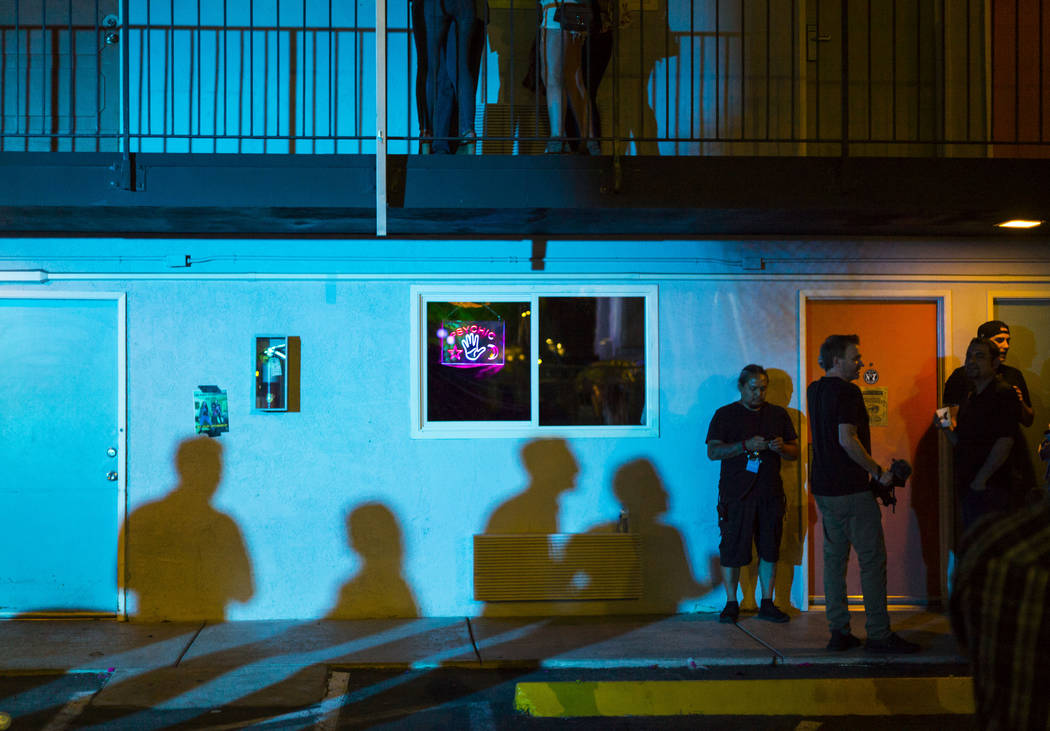 Attendees stand outside of the psychic room during the Jack Daniel's House No. 7, a pop-up expe ...