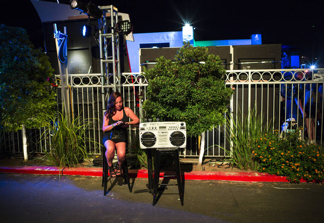 A woman sits next to a boombox during the Jack Daniel's House No. 7, a pop-up experience at the ...