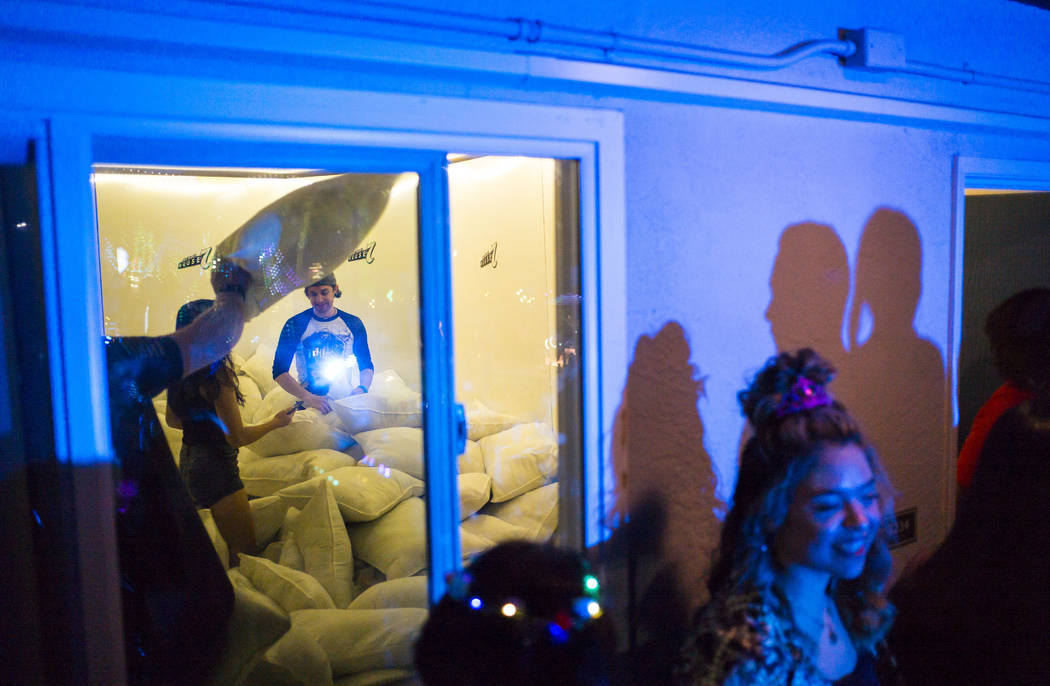 Attendees participate in a pillow fight during the Jack Daniel's House No. 7, a pop-up experien ...