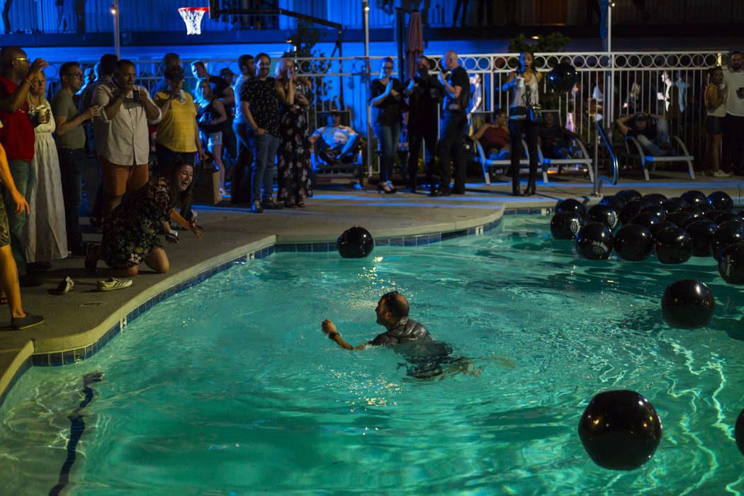 A man swims in the pool during the Jack Daniel's House No. 7, a pop-up experience at the Thunde ...