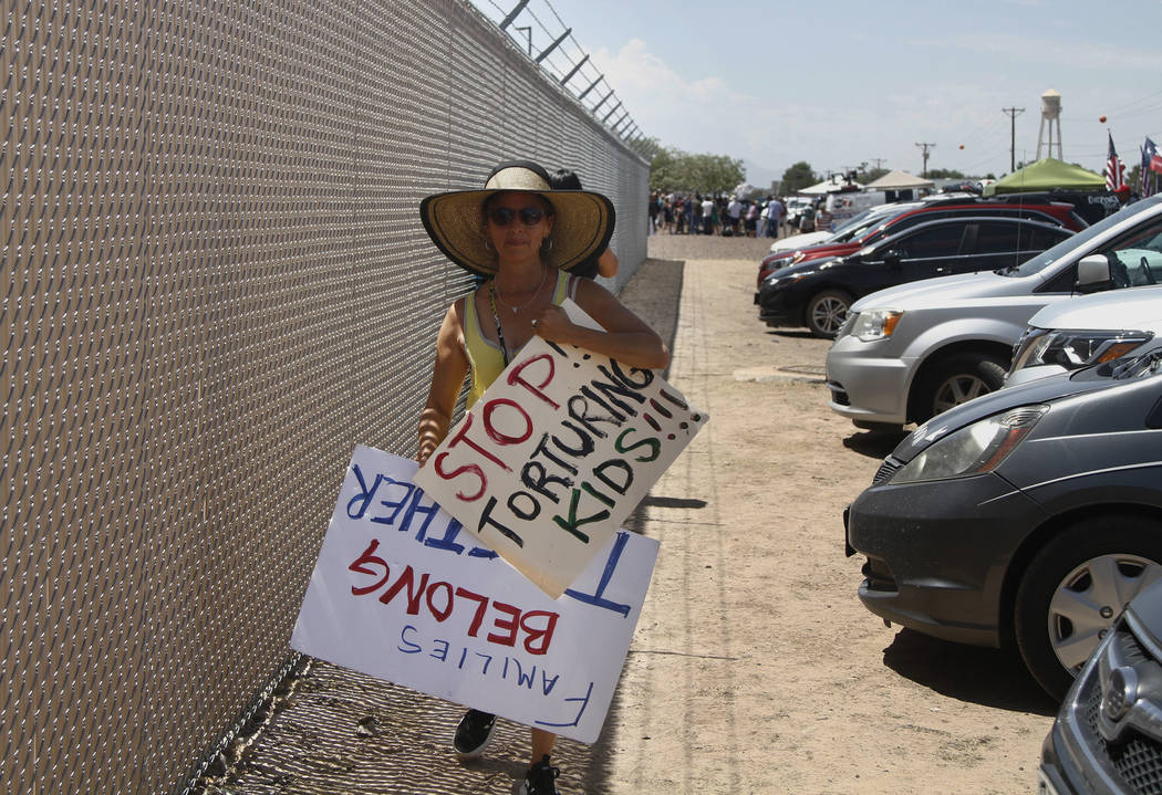 A grandmother protesting the treatment of children in Border Patrol custody walks back to her c ...