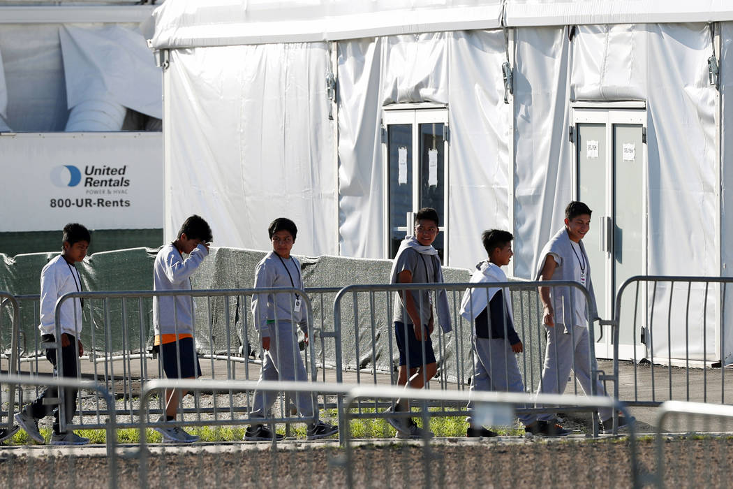 FILE - In this Feb.19, 2019 file photo, children line up to enter a tent at the Homestead Tempo ...
