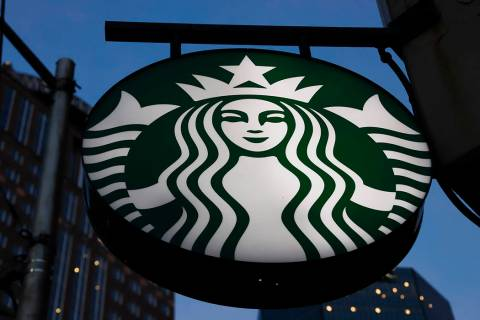 This is the Starbucks sign outside a Starbucks coffee shop in downtown Pittsburgh on Wednesday, ...