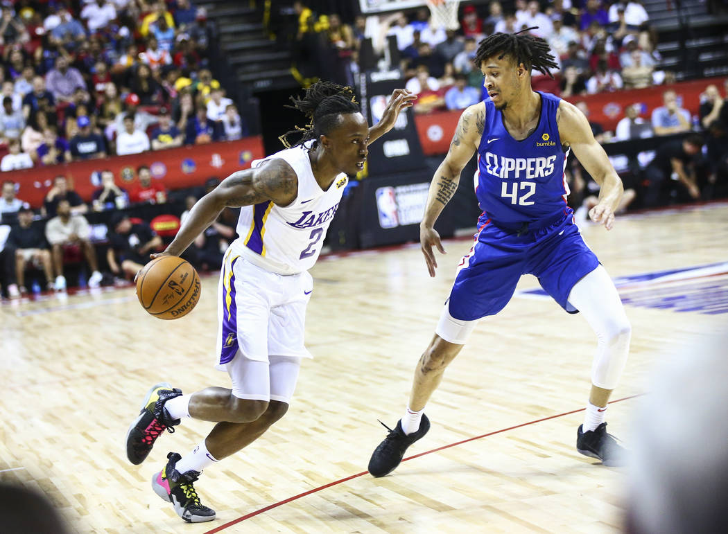 Los Angeles Lakers' Jaron Johnson (2) drives the ball against Los Angeles Clippers' Amir Coffey ...