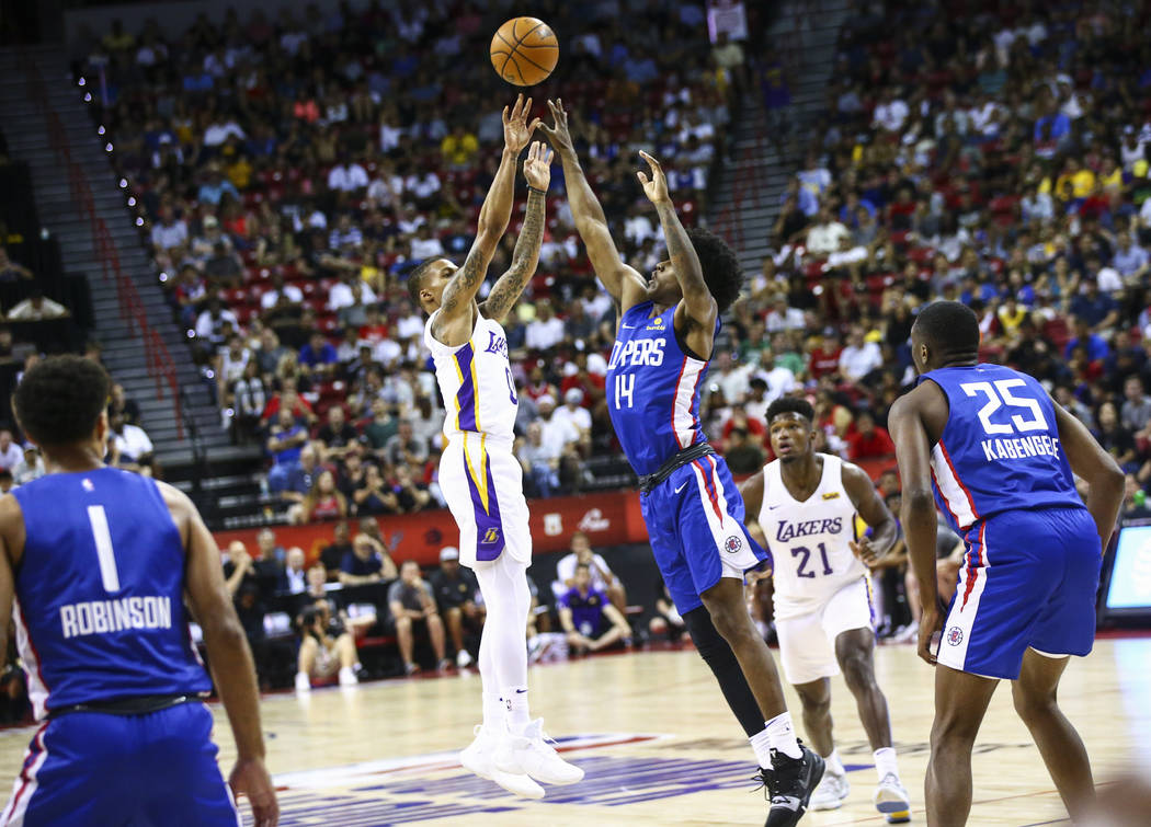 Los Angeles Lakers' Joe Young (0) shoots over Los Angeles Clippers' Terance Mann (14) during th ...