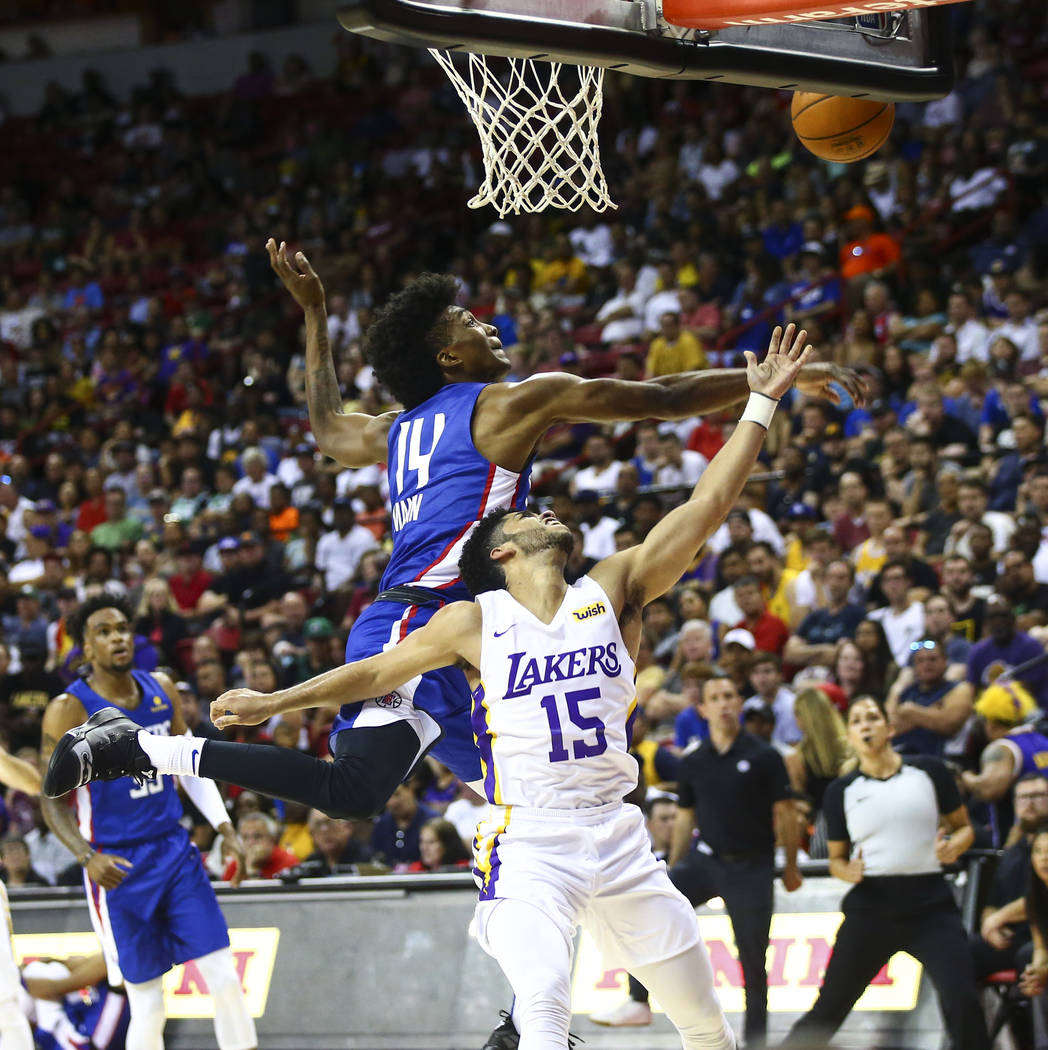 Los Angeles Clippers' Terance Mann (14) blocks a shot from Los Angeles Lakers' Jordan Brown du ...