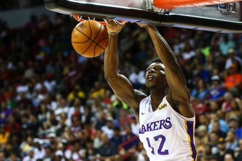 Los Angeles Lakers' Devontae Cacok (12) dunks against the Los Angeles Clippers during the first ...