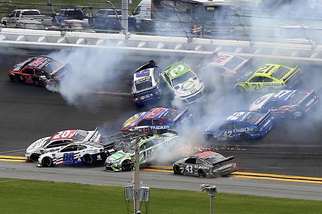 Cars crash, including Alex Bowman (88), Kyle Busch (18), Erik Jones (20), Darrell Wallace Jr. ( ...