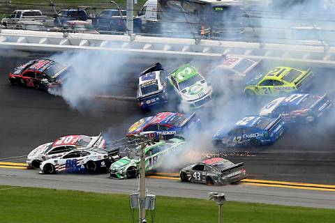 Cars crash, including Alex Bowman (88), Kyle Busch (18), Erik Jones (20), Darrell Wallace Jr. ( ...