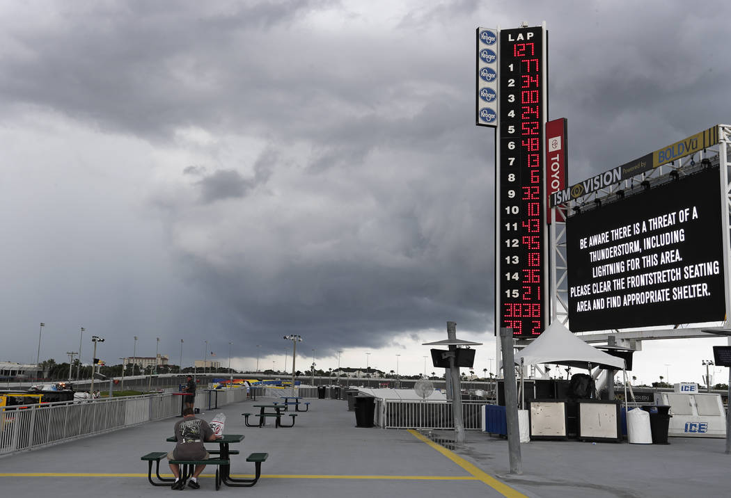 Storm clouds move over the Daytona International Speedway stopping the NASCAR Cup Series auto r ...