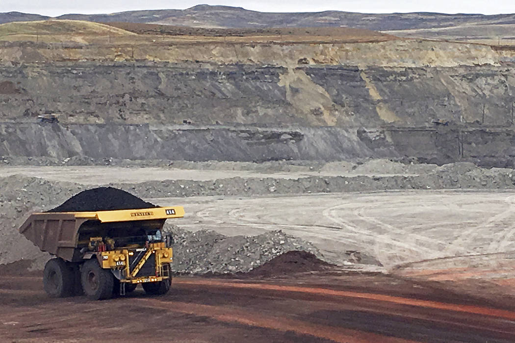 FILE - In this March 28, 2017, file photo, a dump truck hauls coal at Contura Energy's Eagle Bu ...