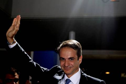 Greek opposition New Democracy conservative party leader Kyriakos Mitsotakis waves to his suppo ...