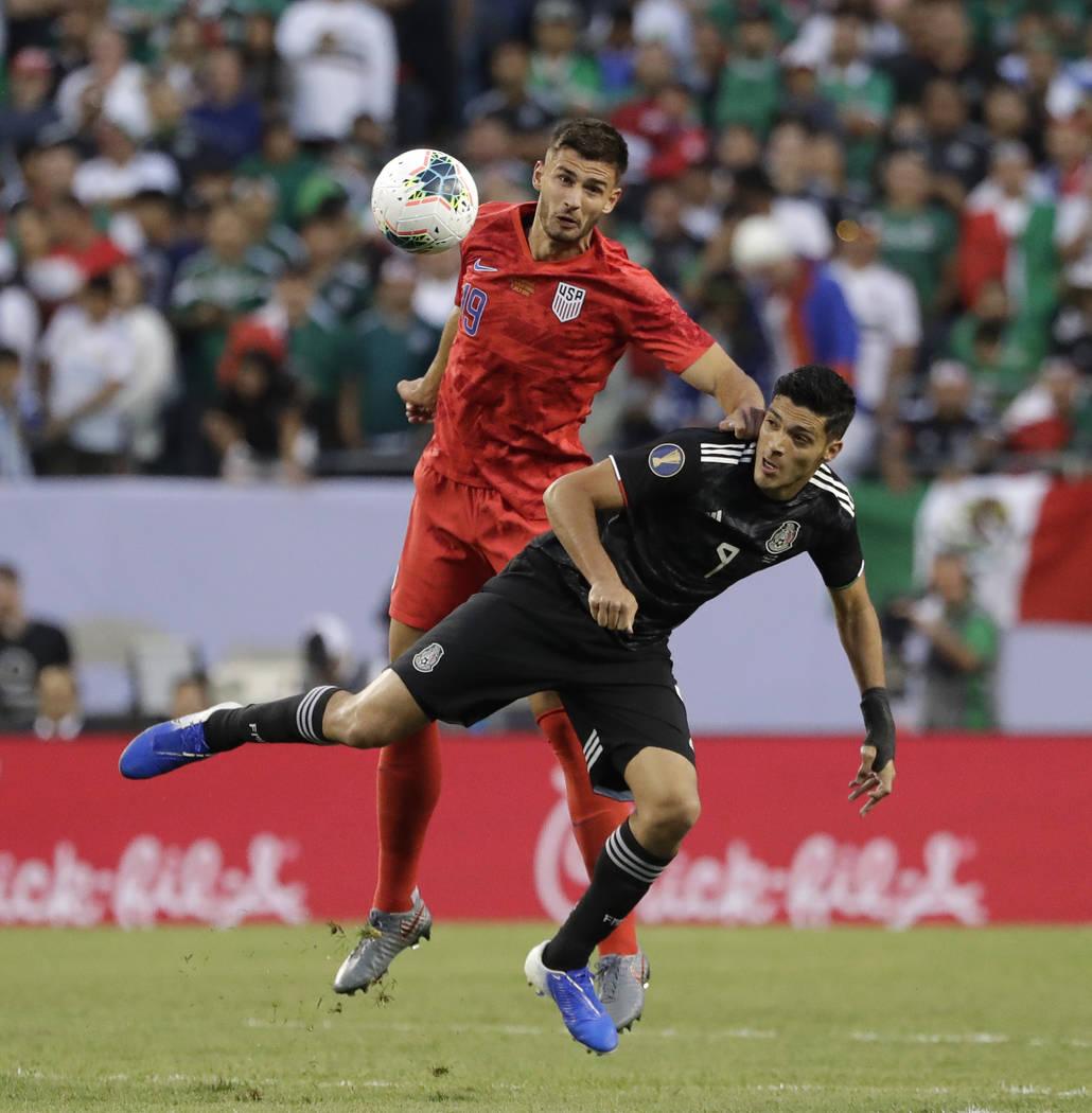 United States defender Matt Miazga, left, and Mexico defender Edson Alvarez battle for the ball ...