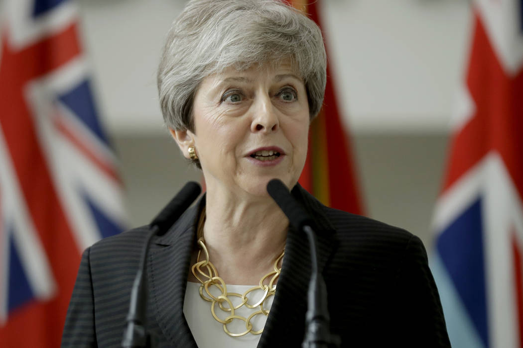 Britain's outgoing Prime Minister Theresa May delivers a speech at headquarters of Joint Forces ...