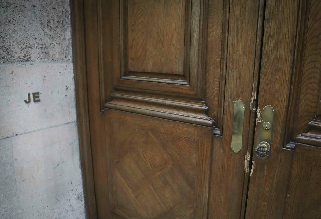 """The initials """"JE"""" and doorway damage at the Manhattan residence of Jeffrey Epstein, Monday July ..."""