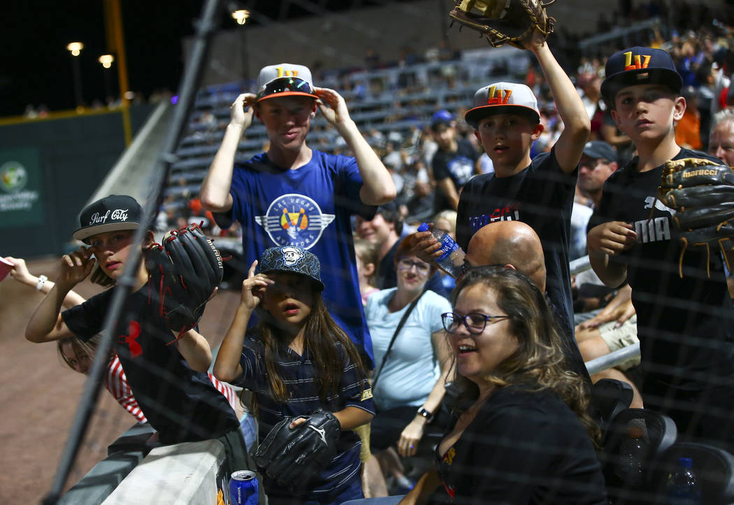 Las Vegas Aviators fans watch for players during the fourth inning at the Las Vegas Ballpark in ...