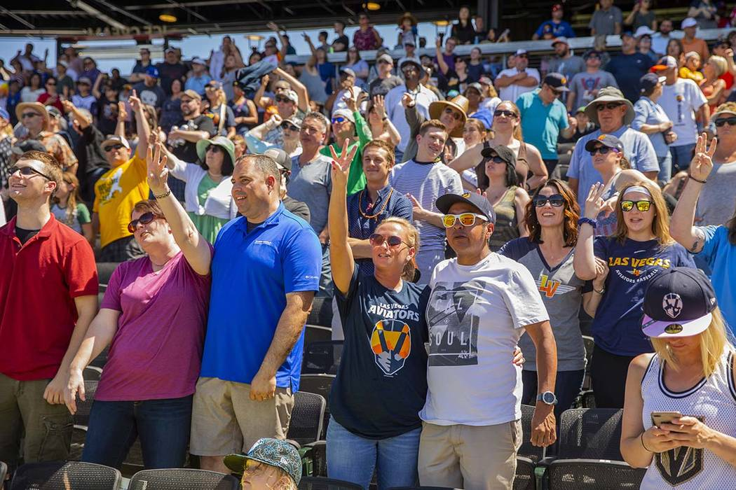 """Aviators fans sing """"take Me Out to the Ballpark"""" during a break in the game versus th ..."""