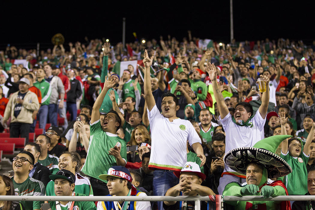 Fans cheer during the men's soccer exhibition match between Mexico and Iceland at Sam Boyd Stad ...