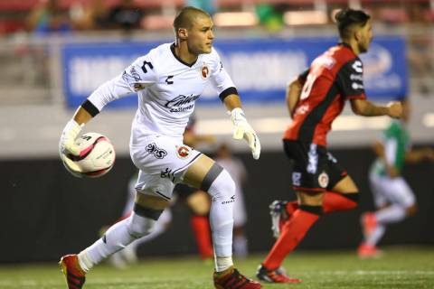 Tijuana's Gibran Lajud (25) passes the ball during an exhibition soccer match against Leon at S ...
