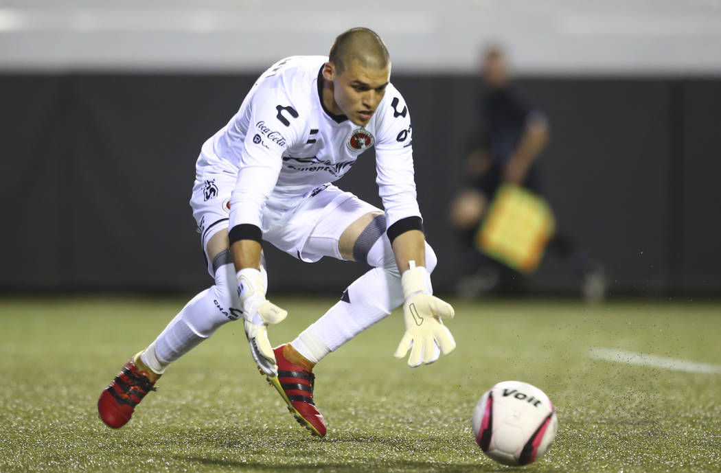 Tijuana's Gibran Lajud (25) reaches to block during an exhibition soccer match against Leon at ...