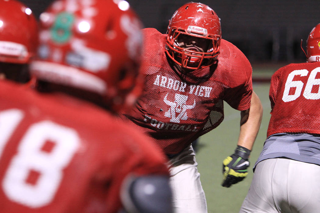Arbor View tackle Malik Noshi runs a play on defense during practice Wednesday, Nov. 19, 2014. ...