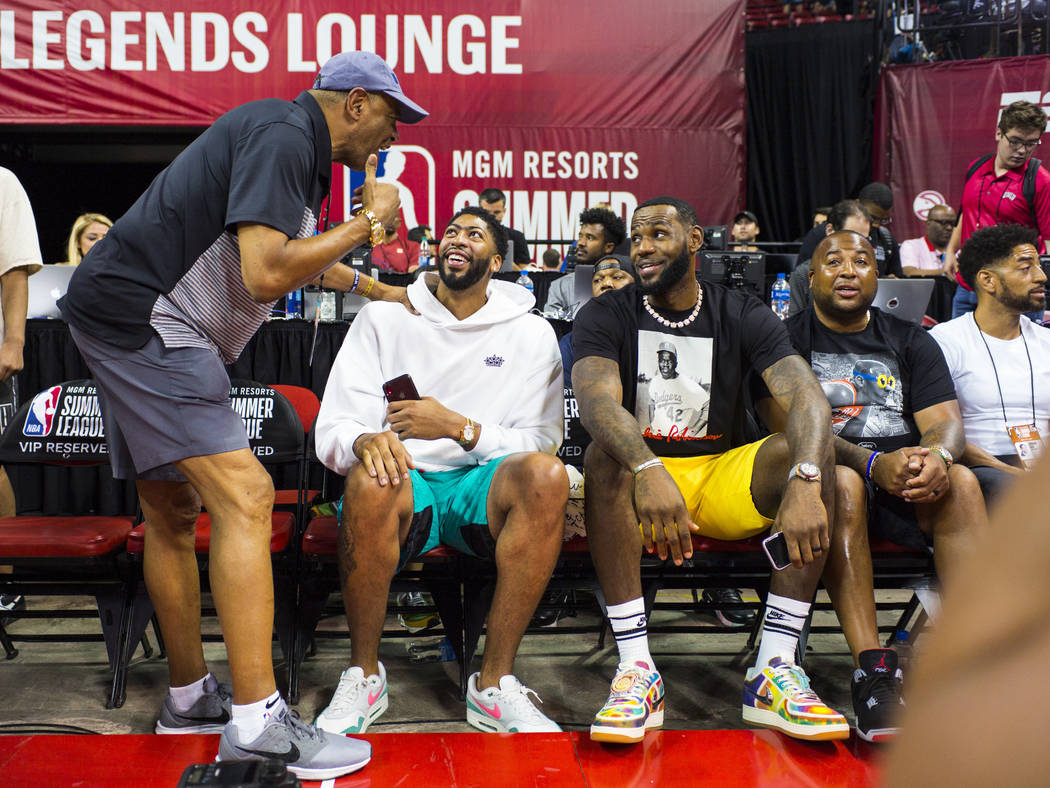 Los Angeles Lakers' Anthony Davis, second from left, and LeBron James mingle with people courts ...