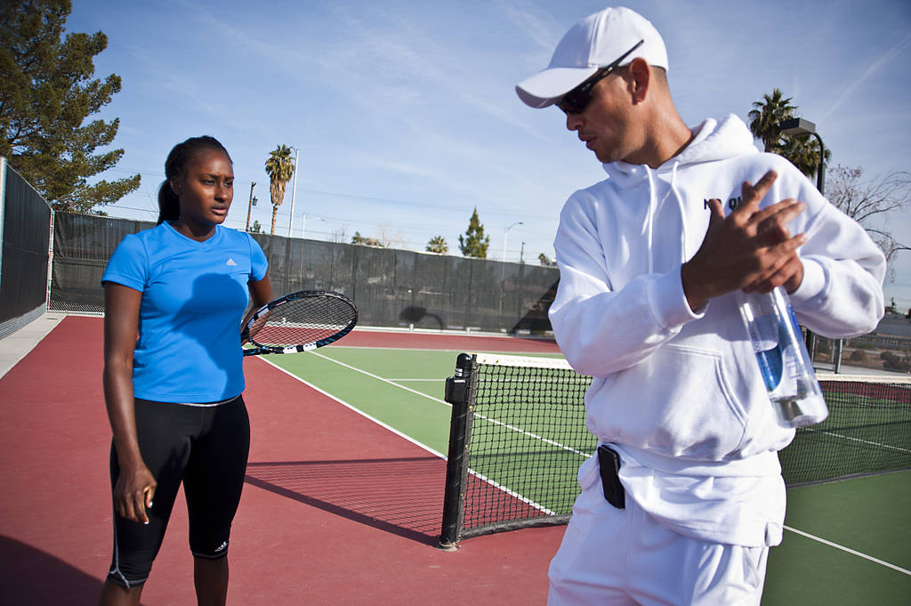 Las Vegas tennis professional Asia Muhammad, left, gets some pointers from her coach, Tim Blenk ...