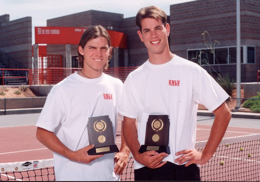 Luke Smith, left, and Tim Blenkiron pose after winning the 1997 NCAA doubles championship. (UNL ...