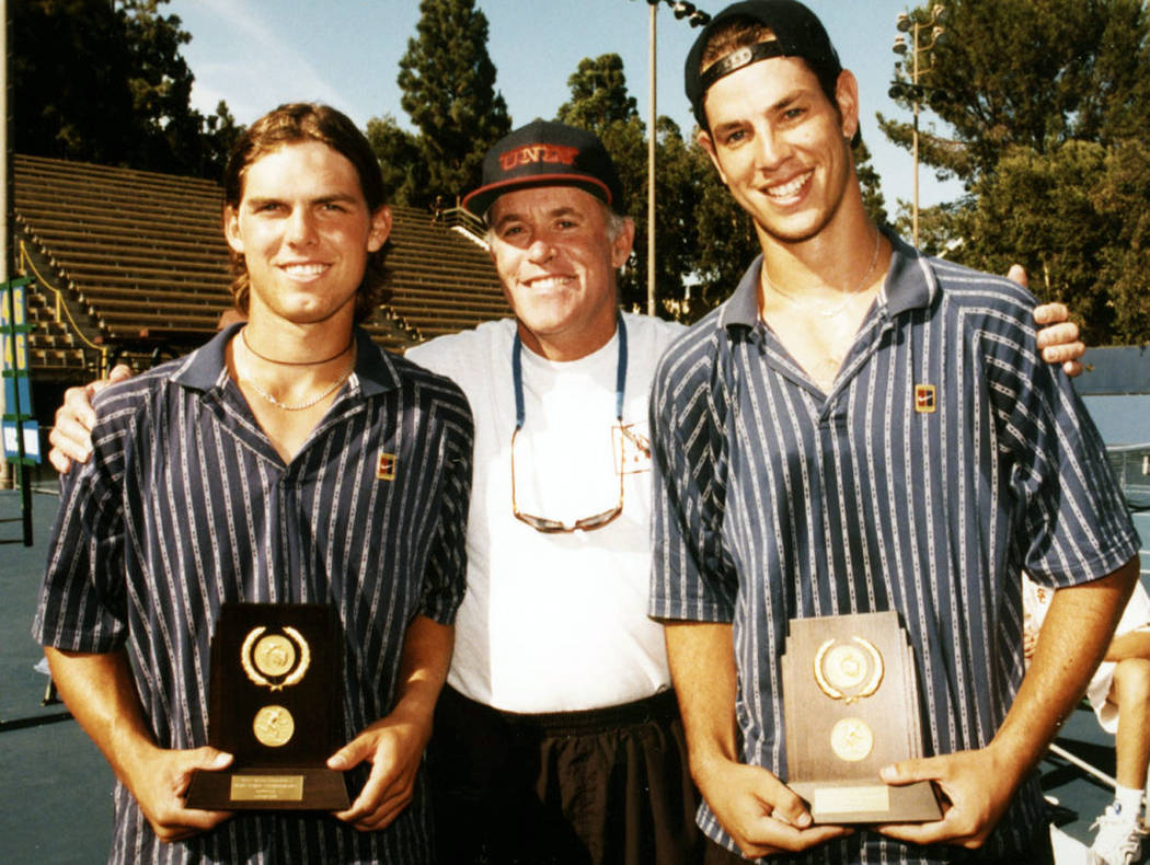 Luke Smith, left, poses with coach Larry Easley and doubles partner Tim Blenkiron at the NCAA t ...