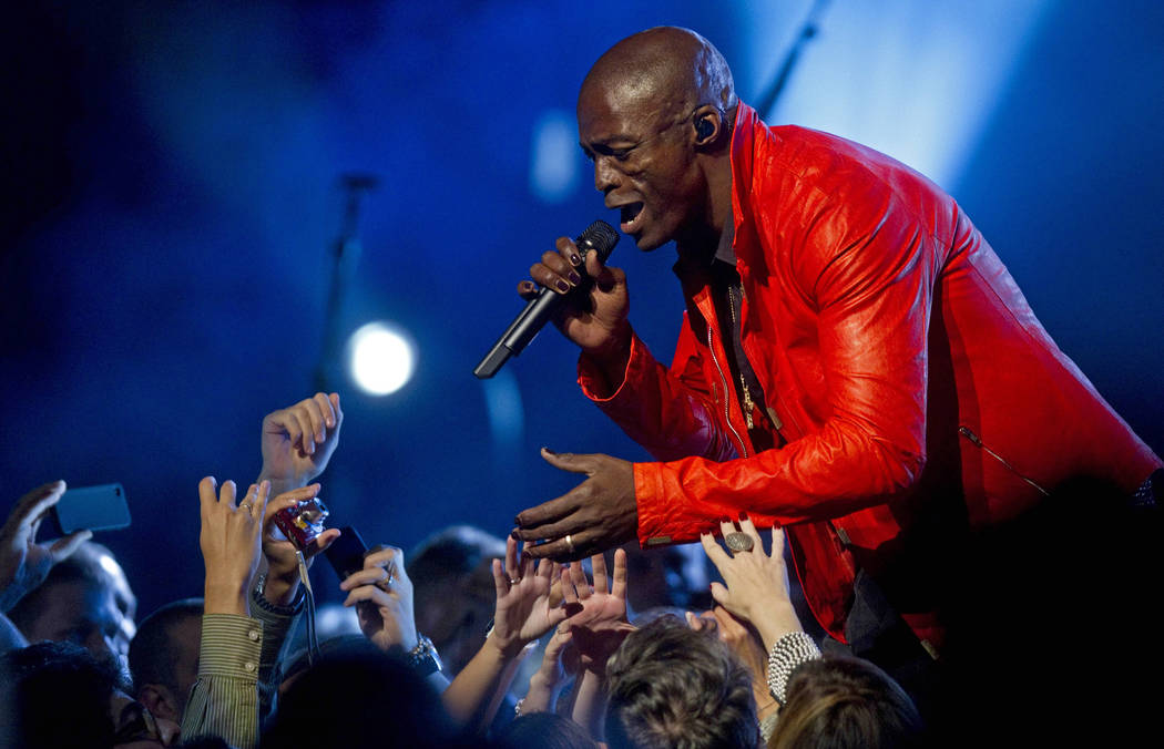 British pop singer Seal performs in Sao Paulo, Brazil, Thursday March 17, 2011. (AP Photo/Andre ...