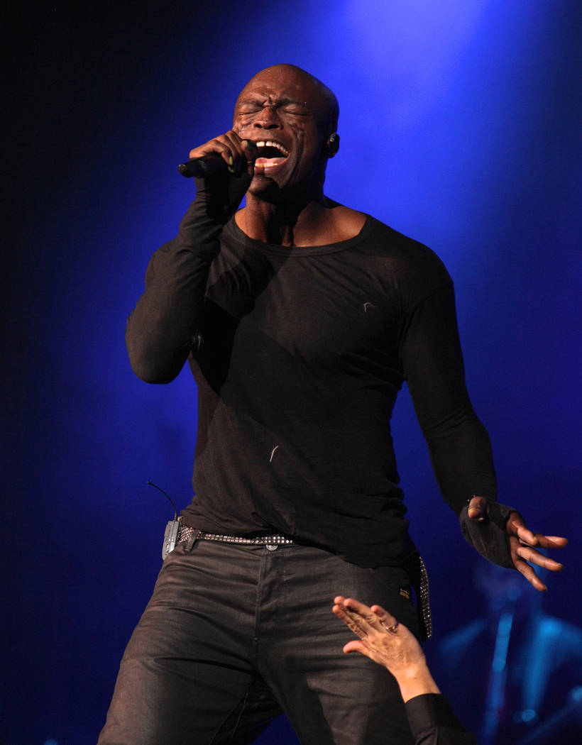 British singer Seal performs on the stage during his concert in Kiev, Ukraine, Friday, Nov. 23, ...