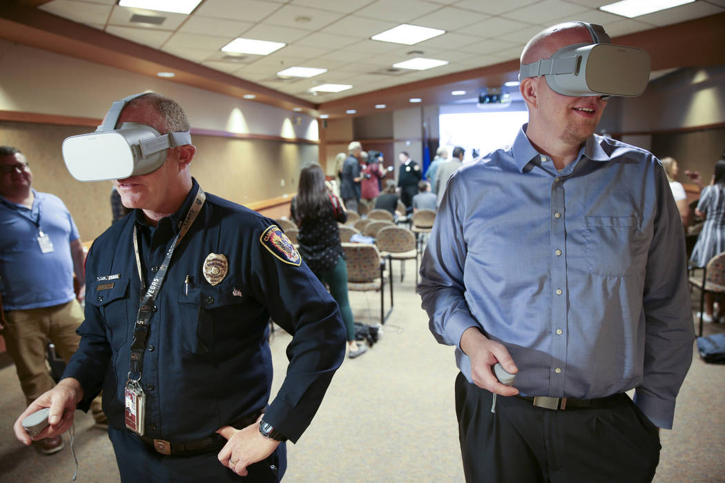 Clark County Fire Department Chief Greg Cassell, left, and Mike Warnick, a senior engineer with ...