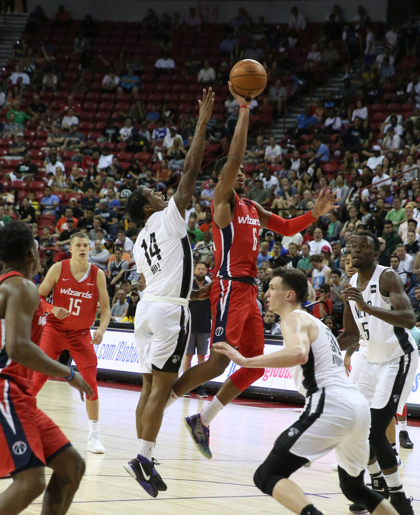 The Washington Wizards' forward Troy Brown Jr. (6) goes for the basket as the Brooklyn Nets' gu ...