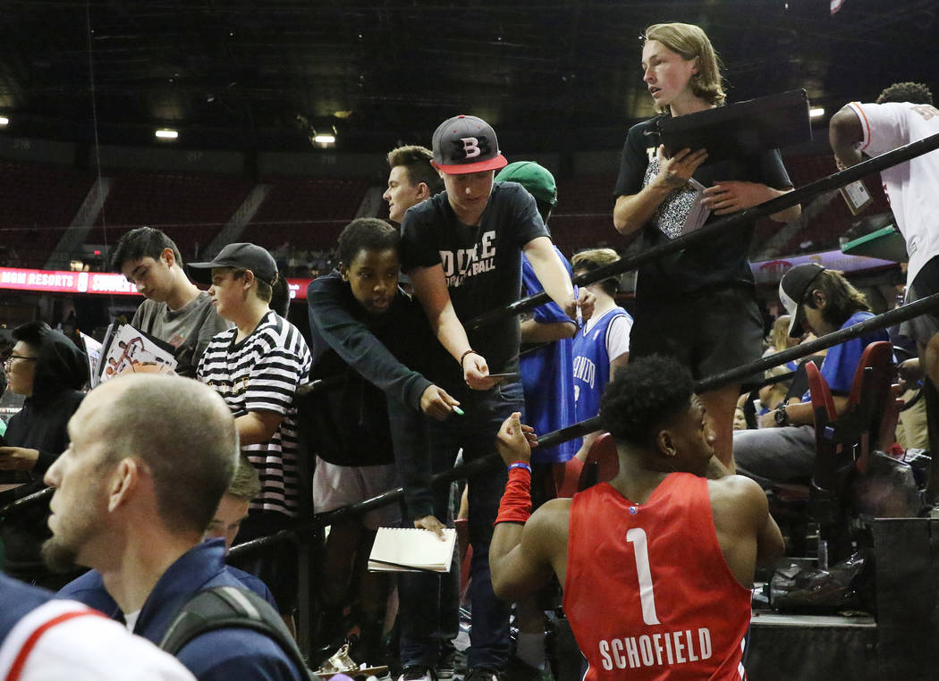 The Washington Wizards' forward Admiral Schofield (1) signs autograph after playing against the ...