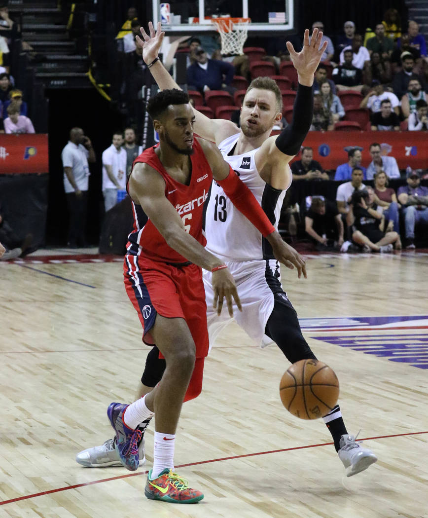 The Washington Wizards' forward Troy Brown Jr. (6) passes the ball as the Brooklyn Nets' forwar ...