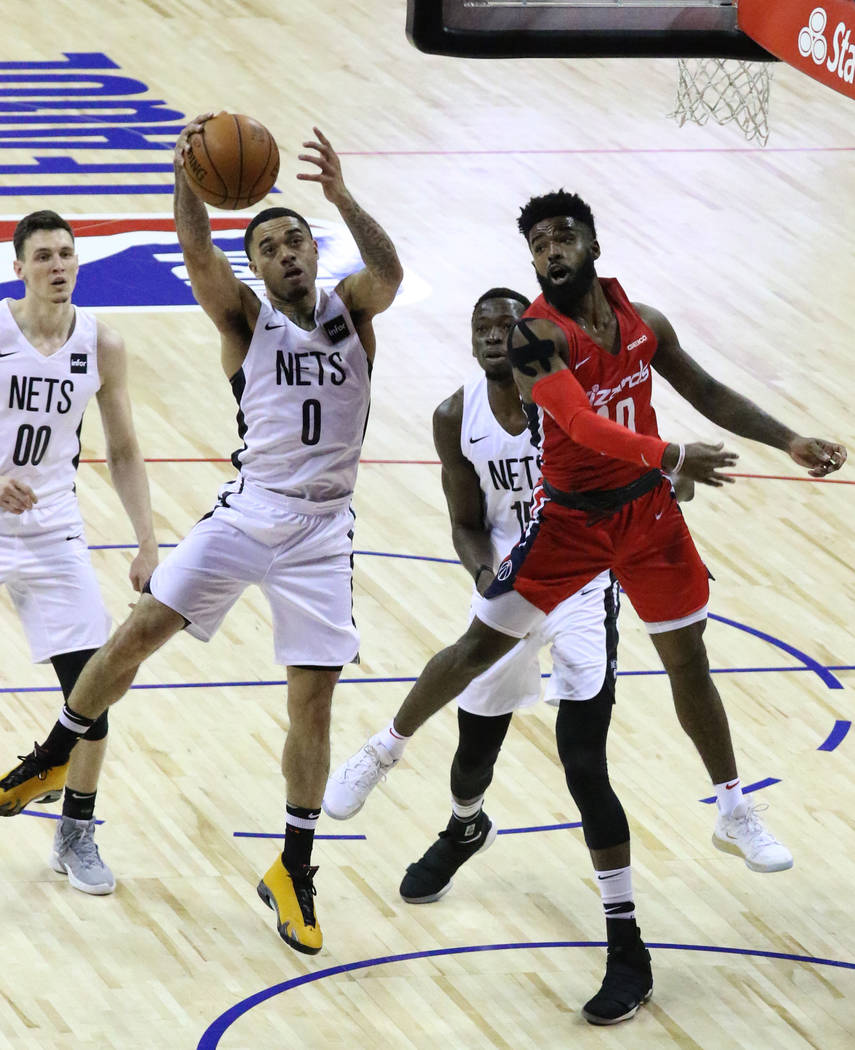 The Brooklyn Nets' guard Josh Gray (0) goes to the basket as the Washington Wizards' guard Core ...