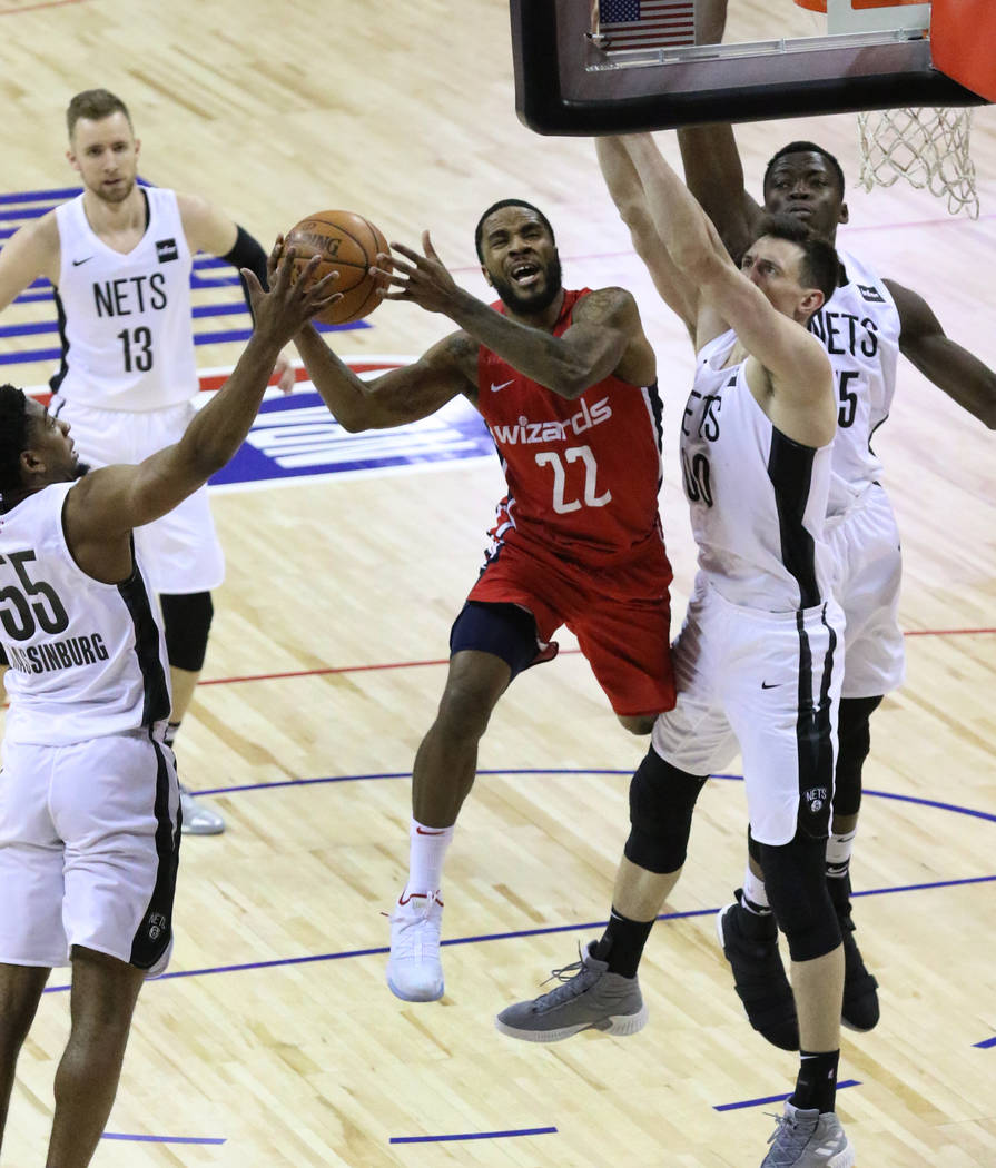 The Washington Wizards' guard Tarik Philip (22) goes for the basket as the Brooklyn Nets' guard ...