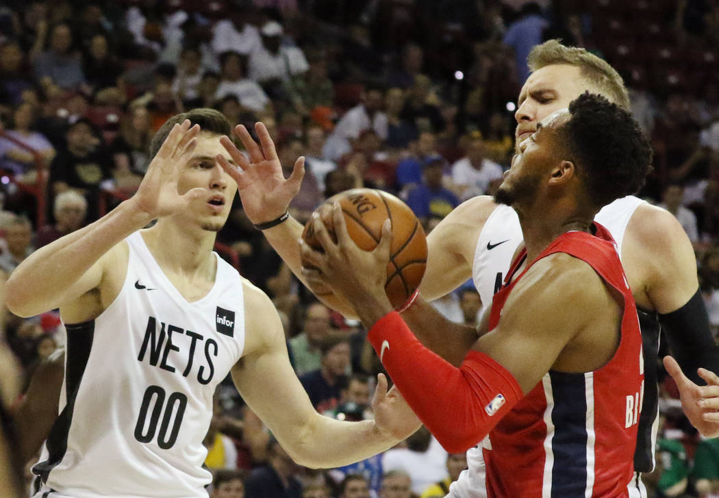 The Washington Wizards' forward Troy Brown Jr. (6) prepares to shoot to the basket as the Brook ...